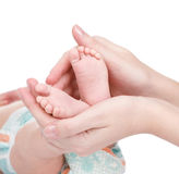 Newborn baby feet cupped into mothers hands. isolated on white Stock Images
