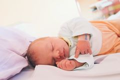 Newborn baby first days of life. Cute little newborn child awake and looking Stock Photography