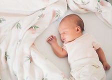 Newborn baby first days of life. Cute little newborn child awake and looking Royalty Free Stock Photos