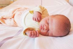 Newborn baby first days of life. Cute little newborn child awake and looking Royalty Free Stock Image