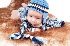 Newborn baby in funny hat Stock Photos