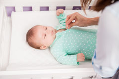 Newborn baby getting dressed by her mom Royalty Free Stock Photography