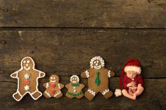 Newborn baby with gingerbread cookie family stock photo