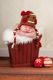 Newborn Baby in Gingerbread Girl Hat Stock Image
