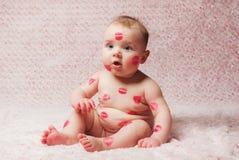 Newborn baby gir filled kisses Stock Image