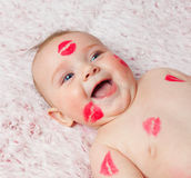 Newborn baby gir filled kisses stock photo