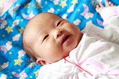 Newborn baby girl Stock Photos