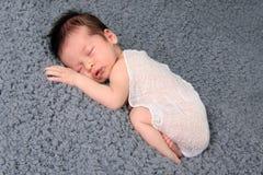 Newborn baby girl. Asleep on a blanket Stock Photo