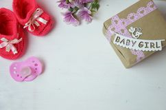 A newborn baby girl background. Newborn accessories for a baby girl on a pink wooden background. A newborn baby girl background. Newborn accessories for a baby Royalty Free Stock Photo