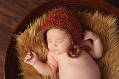 Newborn Baby Girl with Bonnet Royalty Free Stock Photography