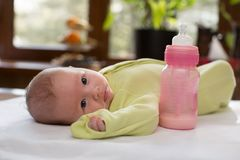 Newborn baby girl with a bottle of milk Royalty Free Stock Photos