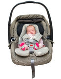 Newborn baby girl in a car seat Royalty Free Stock Photography