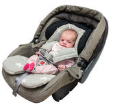 Newborn baby girl in a car seat Royalty Free Stock Photos
