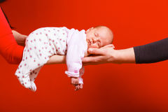Newborn baby girl in the comfort of moms arms Royalty Free Stock Photos