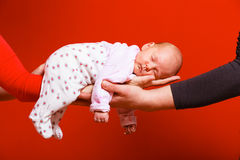 Newborn baby girl in the comfort of moms arms Stock Photo