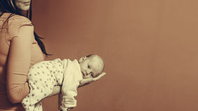 Newborn baby girl in the comfort of moms arms Royalty Free Stock Photography