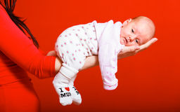 Newborn baby girl in the comfort of moms arms Royalty Free Stock Images