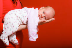 Newborn baby girl in the comfort of moms arms Royalty Free Stock Photo