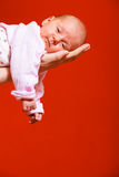 Newborn baby girl in the comfort of moms arms Stock Photos