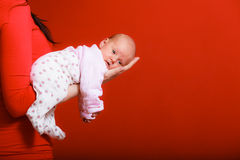 Newborn baby girl in the comfort of moms arms Stock Photography