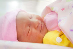 Newborn Baby Girl Cozy & Sleeping Royalty Free Stock Images
