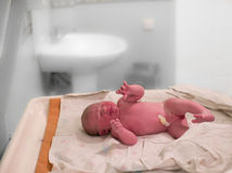 A newborn baby girl cries moments after birth. Is being measured in hospital Royalty Free Stock Photos