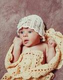 Newborn baby girl. On the crochet blanket Royalty Free Stock Image