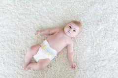 Newborn baby girl with diapers. Dry skin and nursery Royalty Free Stock Image