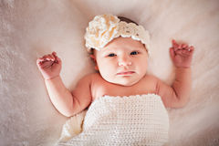 Newborn baby girl with flower hair band Stock Photos
