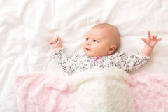 Newborn baby girl on her blanket royalty free stock photography