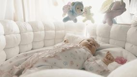 Newborn baby girl in her cot Royalty Free Stock Photography