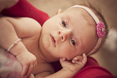 Newborn baby girl in her mothers arms Stock Images