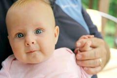 Newborn Baby Girl Holding Grandpa's Hand royalty free stock image
