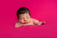 Newborn Baby Girl on Hot Pink Background Stock Photo