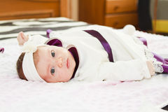 Newborn baby girl looking at camera Stock Image