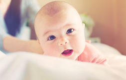 Newborn baby girl lying being cared for Royalty Free Stock Images