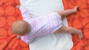 Newborn baby girl lying on blanket. stock footage