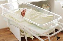 Newborn baby girl in maternity hospital. 3 days Stock Photo