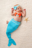 Newborn Baby Girl in a Mermaid Costume Stock Images