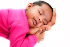 Newborn baby girl peaceful and asleep in hands Stock Photo