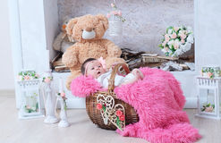 Newborn baby girl in pink blanket lying in basket. Cute card composition Royalty Free Stock Image