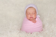 Newborn Baby Girl with Pink Bonnet and Swaddle Royalty Free Stock Photography