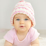 Newborn baby girl in pink knitted hat. Stock Photography