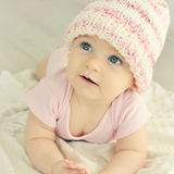 Newborn baby girl in pink knitted hat. A cute little baby. Newborn baby girl in pink knitted hat. Parenting or love concept. Toned photo Stock Image