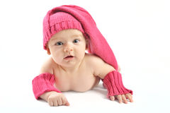 Newborn baby girl in pink knitted hat and mittens Stock Images