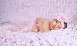 Newborn baby girl with pink tutu. Newborn baby girl wearing a pink ballerina tutu Royalty Free Stock Photo