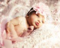 Newborn baby girl with pink tutu. Newborn baby girl wearing a pink ballerina tutu Royalty Free Stock Images