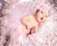 Newborn baby girl with pink tutu. Newborn baby girl wearing a pink ballerina tutu Stock Photos