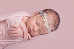 Newborn baby girl in pink royalty free stock image
