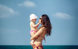 Newborn baby girl playing with mom. Stock Photography